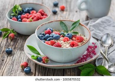 Tasty oat flakes for breakfast in summer garden