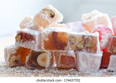 Tasty oriental sweets (Turkish delight lokum) with powdered sugar.