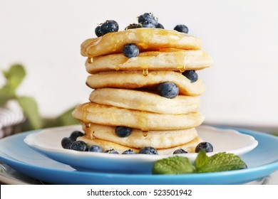 Tasty pancakes with blueberry on plate