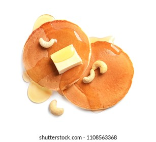 Tasty pancakes with butter and honey on white background