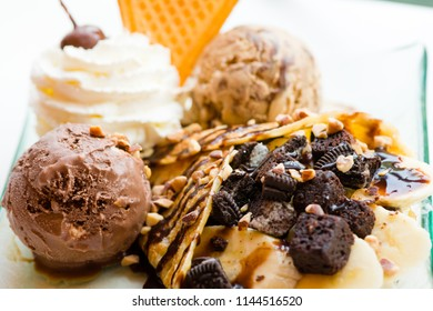 tasty pancakes with chocolate ice cream crispy waffle whipped cream with brownies cherry almond and chocolat syrup on top.served pancakes crepes on plate.sweets dessert brownies pancakes crepes.