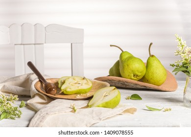 Tasty pears with honey and nuts on wooden table.