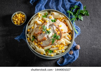 Tasty penne with chicken, corn and bechamel sauce