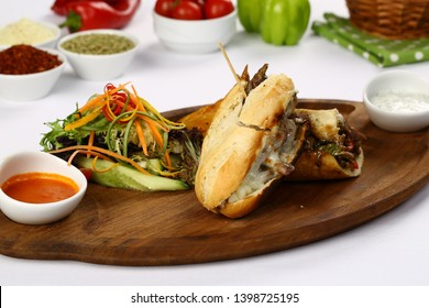 Tasty Philly Beef Steak Sandwich with melted cheese and french fries