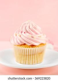 Tasty pink cupcake, closeup