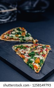 Tasty pizza with spinach and ingredients on a background. Top view