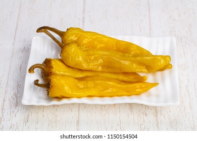 Tasty plate of salty pickled peppers
