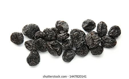 Tasty prunes on white background