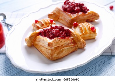 Tasty puff pastry dessert on plate