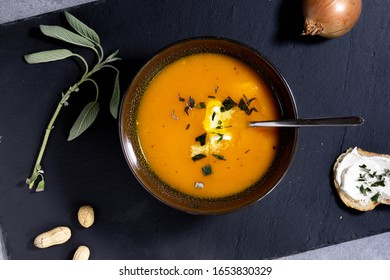 tasty pumpkin soupe in a bowl with onions
