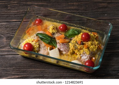 Tasty raw ingridients ready for cooking dish of chicken with millet in glass form