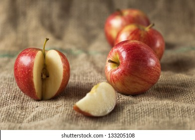Tasty red apples whit slice on table.Organic food production