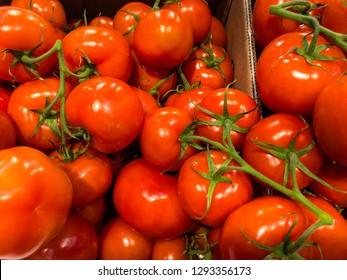Tasty red tomatoes in the box.