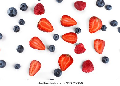 Tasty ripe berries on wooden table close up