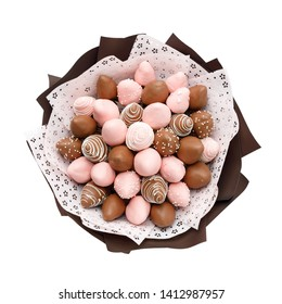Tasty ripe strawberries in brown and pink chocolate in the form of a bouquet on a white background. Top view