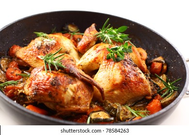 Tasty roasted chicken with vegetable and herbs
