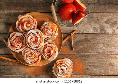 Tasty rose shaped apple pastry on wooden table