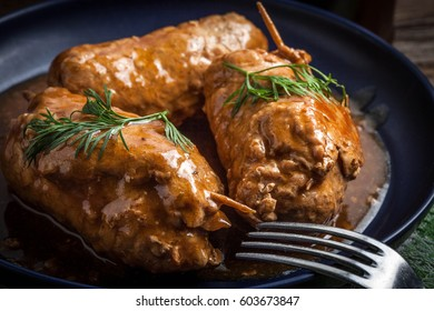 Tasty roulades beef on plate with sauce, close up.