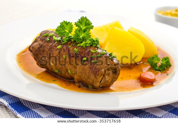 Tasty roulades beef on plate with potato, sauce, close up