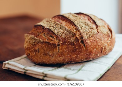 Tasty rustic bread on wooden table