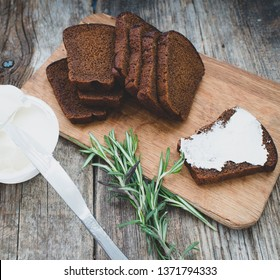 Tasty rye bread and butter on background,close up