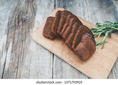 Tasty rye bread on background,close up