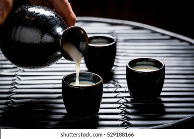 Tasty sake in Asian restaurant on black table