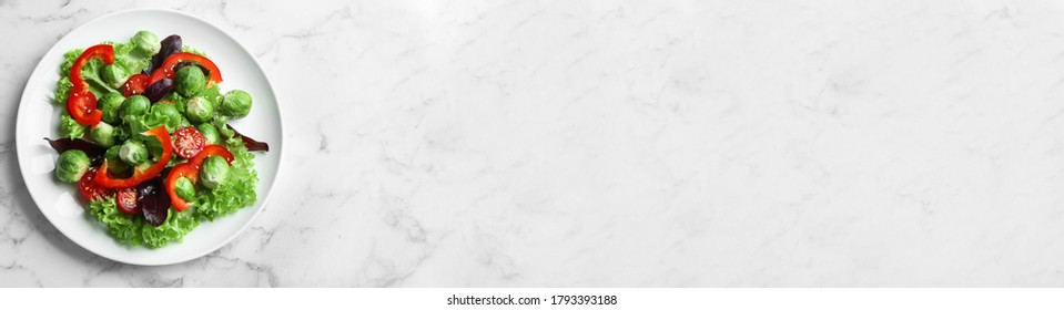 Tasty salad with Brussels sprouts and space for text on white marble table, top view. Banner design