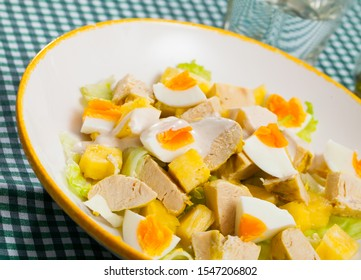 Tasty salad with chicken,  egg and sweet pineapple at plate