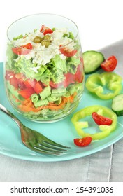 Tasty salad with fresh vegetables, isolated on white