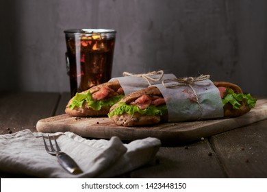 Tasty salmon sandwich with cola