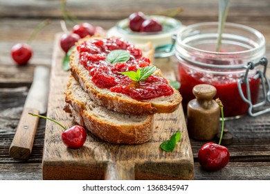 Tasty sandwich with jam made of cherries