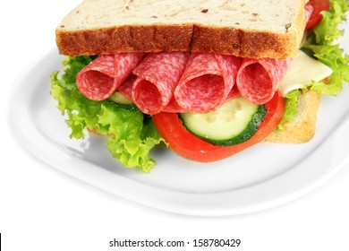 Tasty sandwich with salami sausage and vegetables on white plate, isolated on white