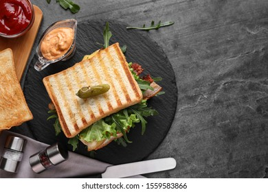 Tasty sandwich with toasted bread served on grey table, flat lay. Space for text