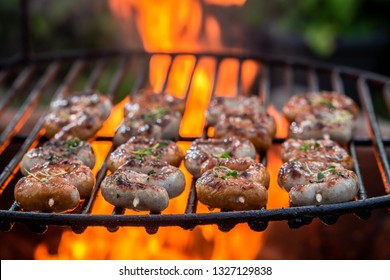 Tasty sausage on grill with herbs and spices
