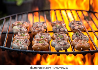 Tasty sausage on grill with herbs and spices in summer