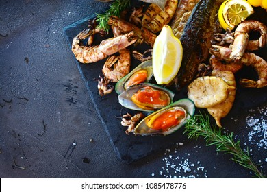 Tasty seafood on a table of a restaurant cuisine. Mediterranean cuisine.