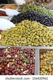 tasty seasoned olives for sale at vegetable market directly from producer to consumer