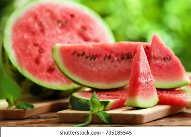 Tasty sliced watermelon on table outdoors