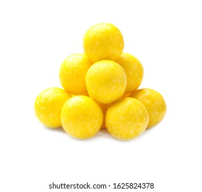 Tasty small lemon drops isolated on white