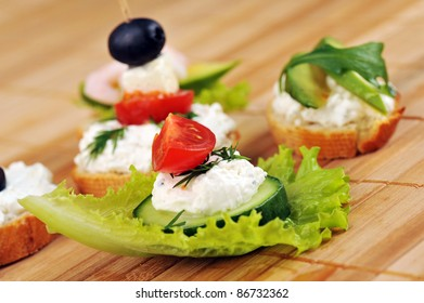 Tasty small sandwich from vegetables and cheese on  bamboo napkin