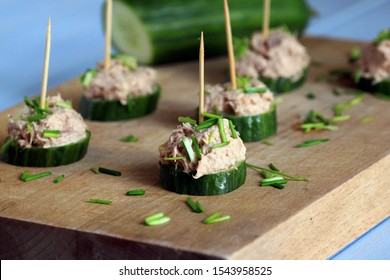 A tasty snack with cucumber and tuna. Party appetizer. Small sandwiches with cucumber and tuna paste.