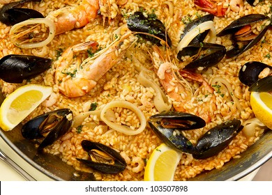 Tasty spanish paella with seafood photographed close