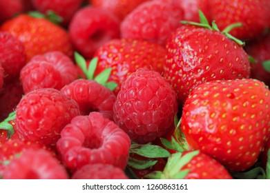 tasty strawberries and raspberries background