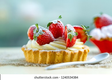 Tasty strawberry cake with whipped cream and with fresh strawberries. Pastry. Sweet tartlets dessert