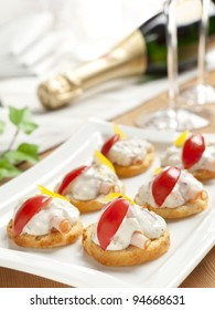 Tasty canapé style starters with creamy topping and tomato and ham rolls