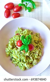Tasty Summer dish with rice, pesto, Sicilian tomato