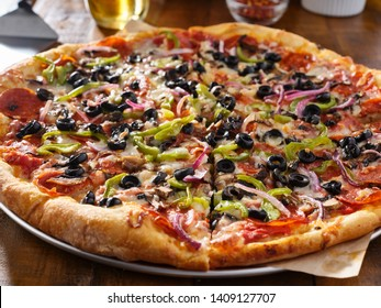 tasty supreme pizza with olives peppers onions and sausage