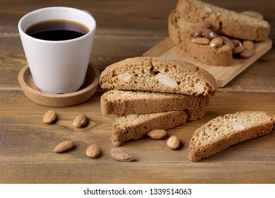 Tasty Sweet Cantuccini Biscuits Italian Sweet Dessert Biscotti on Wooden Background Italian Dessert for Coffee or Wine Biscotti and cup of Coffee Horizontal