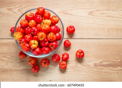 tasty sweet and fresh cherries in a glass bowl on wood table